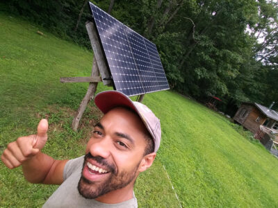 man by solar panel