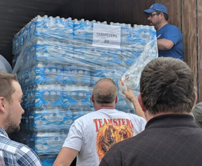 people delivering bottled water