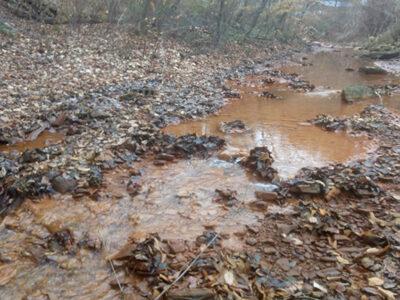 An orange-tinted creek