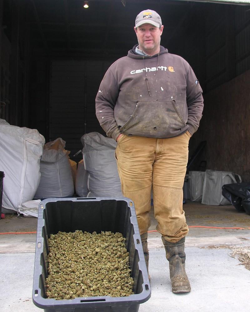 man by bucket of hemp