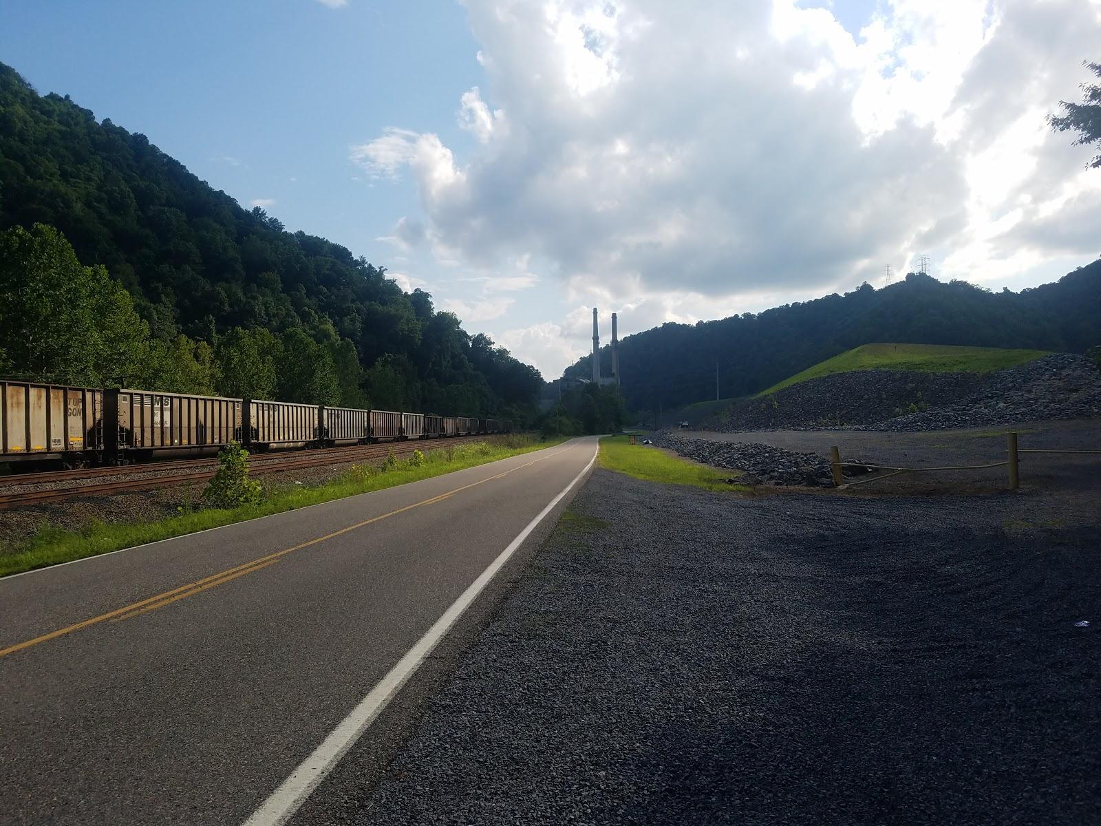 Empty train cars along a mountain road