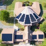 aerial view of a church with solar panels