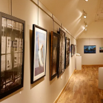 view of gallery with art on the wass