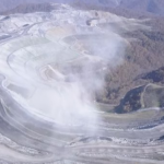 dust rising from surface mine