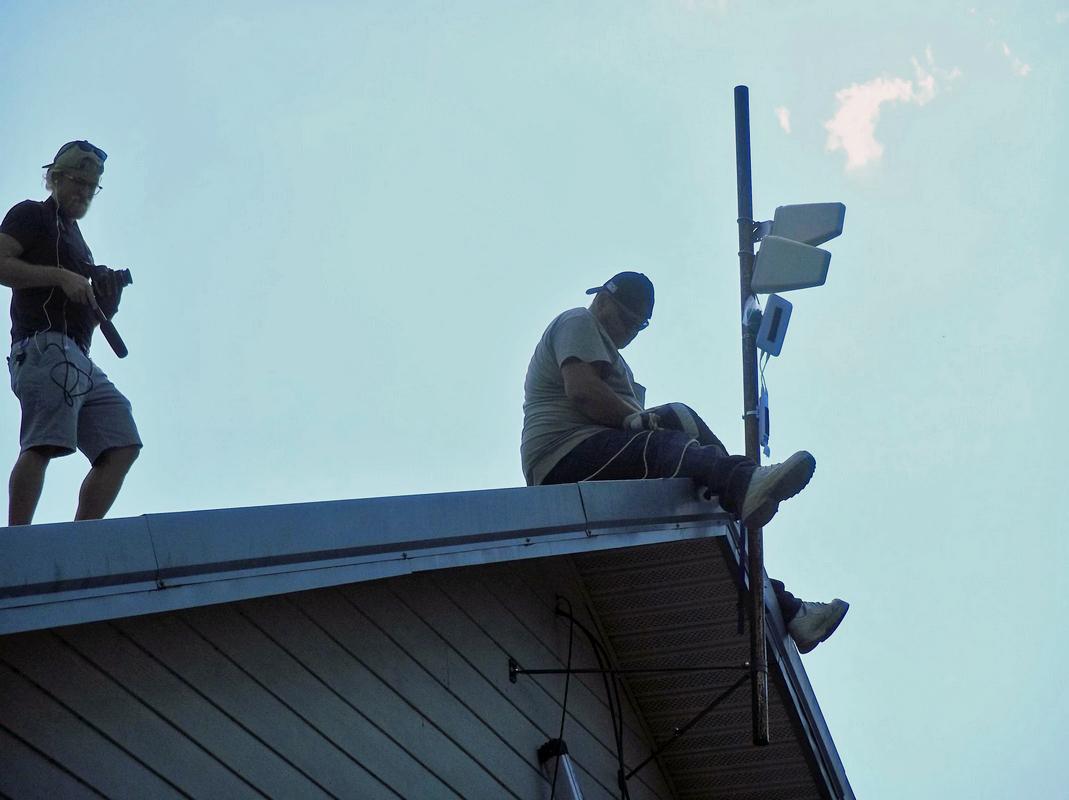 people installing antenna