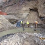 workers cleaning up mine site