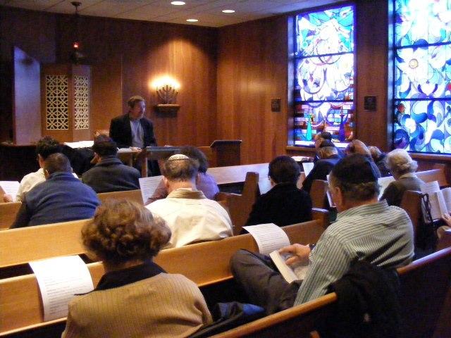 congregants listen to the rabbi