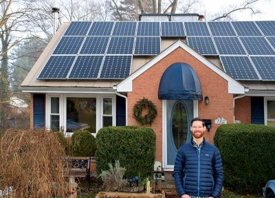 Appalachian Voices' Peter Anderson in front of his newly installed home solar panels