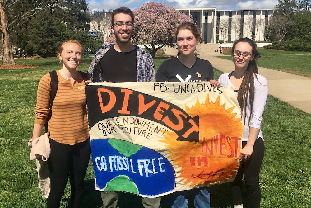 students with banner calling for divestment