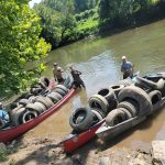 canoes full of tires