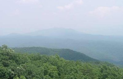 view of a mountain is partially obscured by white haze