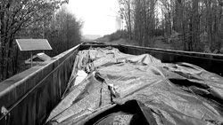 Train cars loaded with coal ash, above, wait to be hauled to Perry County, Ala. for disposal.