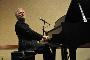 Leavell loves both his trees and his piano, which he would not have without trees. Photo by Roger Gupta.