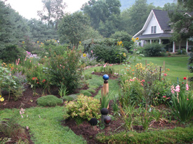 Mulched flower beds offset the lawn areas at Sunflower Farm vacation rental in Barnardsville, N.C. Photo by Joan Naylor