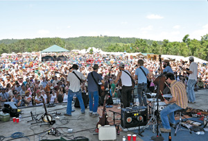 Playing to the crowd at the 2010 FloydFest. Photo by Russ Helgren.